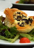 Gorgonzola, artichoke, and olive phyllo tartlet served with green salad.
